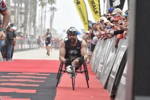 Evan Morgan finishing the IRONMAN 70.3