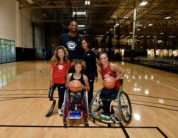 Kobe Bryant with CAF athletes Megan Blunk, Scout Bassett, and Luzy