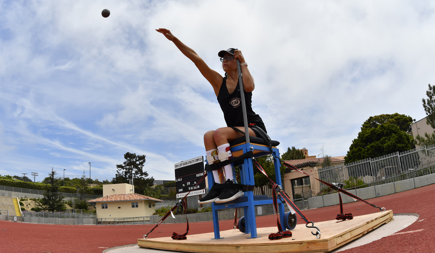 Ruby on her throwing chair for CAF HS Adaptive Track and Field