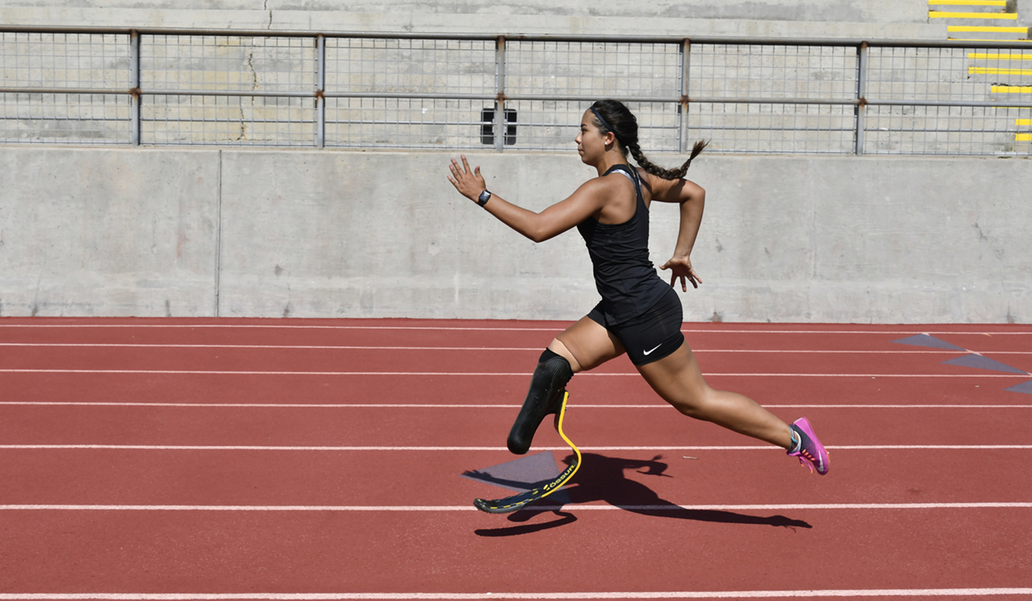 CAF athlete Ella Rodriguez sprinting on the track