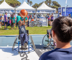 Boy in wheelchair playing basketball at the SDTC Nike Flyease Sport-Zone