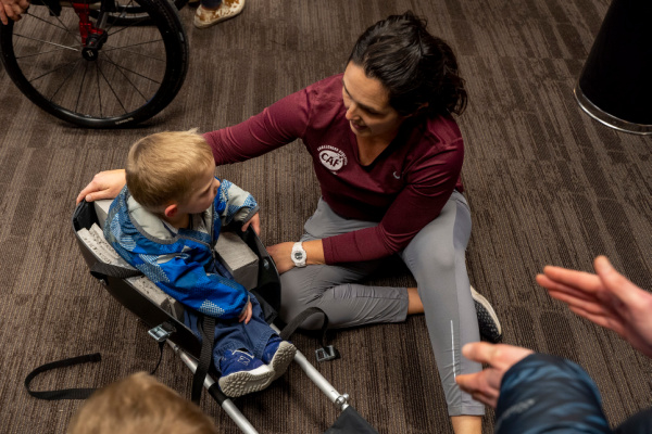CAF Idaho Regional Director Jennifer Skeesick with little boy