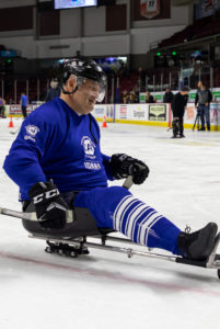 Kevin Holtry playing sled hockey